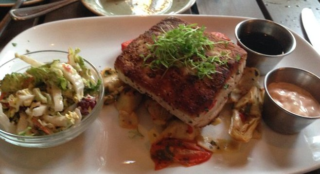 Fresh yellowtail, roasted tomatoes and artichokes, and broccoli slaw at Spike Africa's.