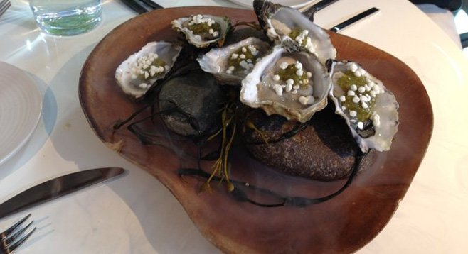 Carlsbad oysters with horseradish pearls and charred tomatillo sauce at Juniper And Ivy