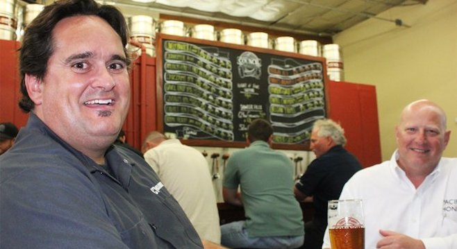 Architect Dustin Hauck (left) enjoying a beer at a brewery he helped bring to fruition, Council Brewing Company in Kearny Mesa.