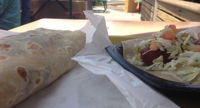 Mano a mano, food style. California burrito and fish taco. Roberto's Very Mexican Food.