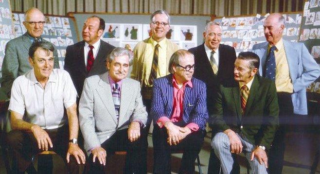 Top row (L to R): Milt Kahl, Marc Davis, Frank Thomas, Eric Larson, and Ollie Johnston.  Bottom row (L to R): Wolfgang Reitherman, Les Clark, Ward Kimball, and John Lounsbery.