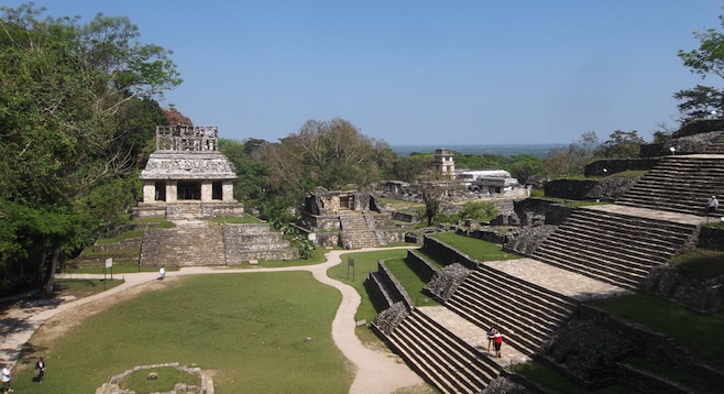 Panorama of the jungle surrounding Palenque, Temple of the Cross in the foreground.