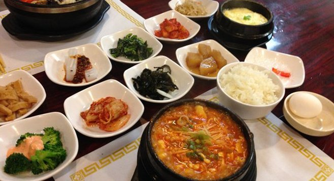 Banchan in the white dishes, left to right: eomuk, cheongpomuk, sigeumchi, ggakdugi, kongnamul, broccoli, kimchi, miyeok, gamja jorim, cheonsachae. Do Re Mi House.