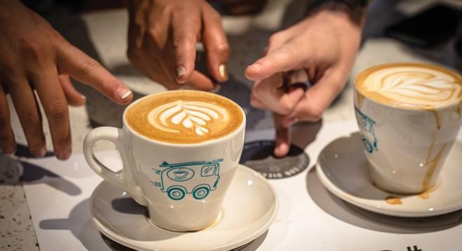 Judges pick winning latte art during the tulip round.