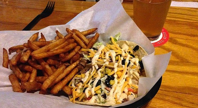Brisket taco, pulled pork taco, beer battered fries and a pint of Nelson. alpine Beer Company.
