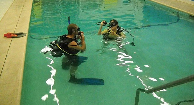 Jason in the pool with Chrissy for a recertification course
