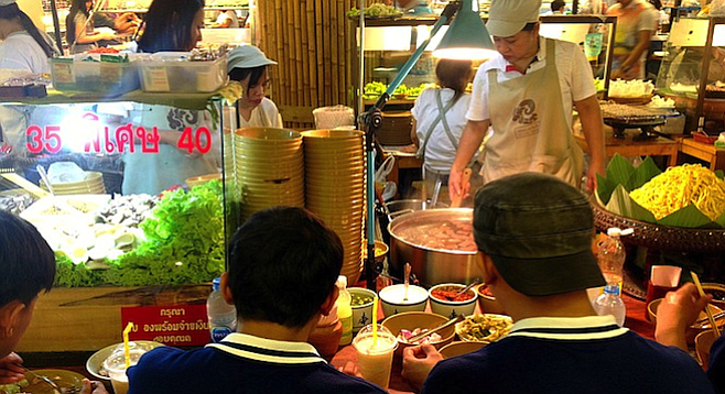 Taking in the savory sounds and smells of Bangkok street food.