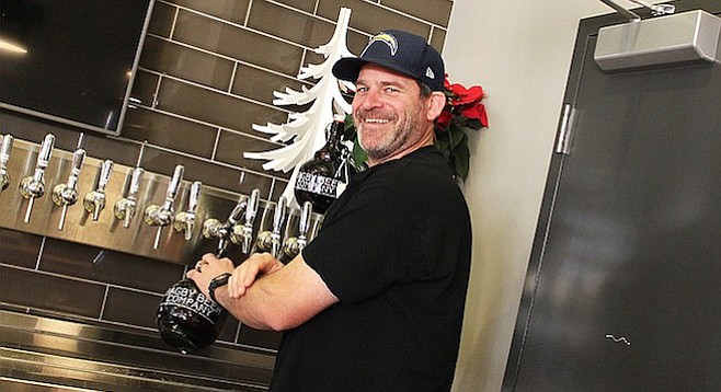 Bagby Beer Company owner and brewmaster Jeff Bagby filling growlers at his Oceanside brewpub