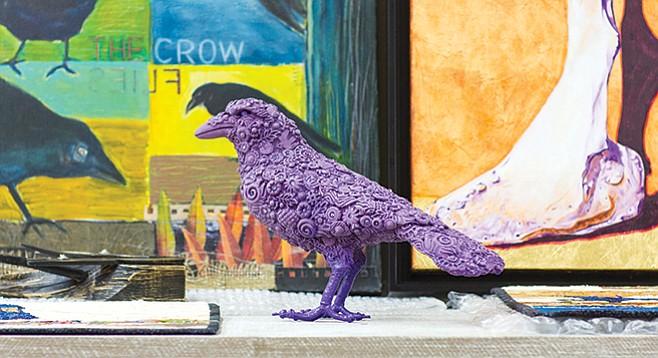 Karla Walter's purple ceramic crow resides at the Studio Door.