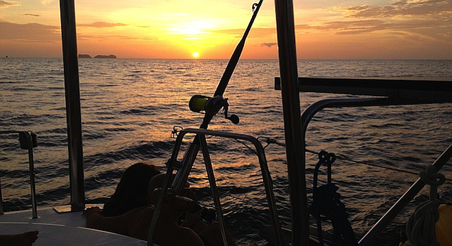 Sunset on the Pacific really does defy description, especially on a party boat.