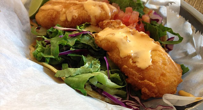 Well-fried cod, I just wish that sauce had some flavor to it. Fried cod taco. Fish District.