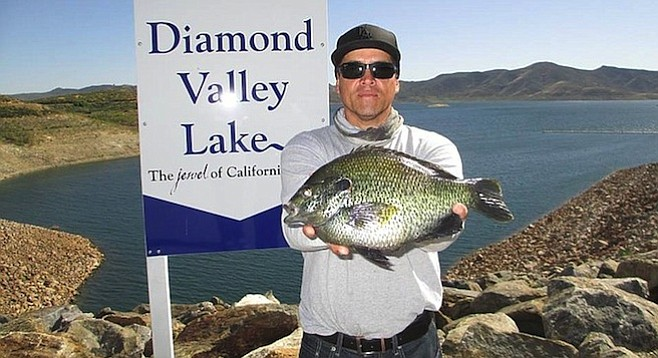 Jesse Mena with large redear sunfish from Diamond Valley Lake.