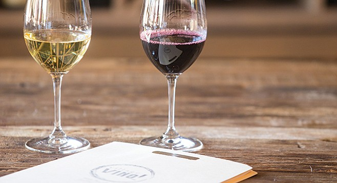 Choose a $6 red or white (or both!) during happy hour at Village Vino