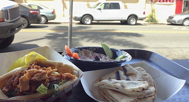 Chicken shawarma sandwich and baba ghanoush, served with a view of OB, kind of