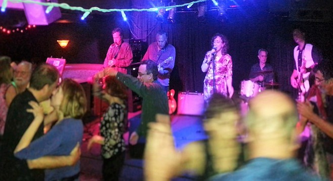 Old-school jazz and blues band Blue Largo fills and thrills the dance floor.