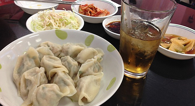 Boiled dumplings with a few banchan and complimentary barley water