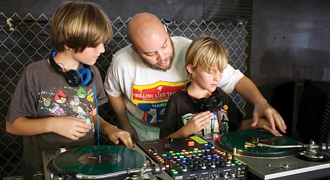 Vinyl Junkies get kids hooked on records by setting them up behind the decks.