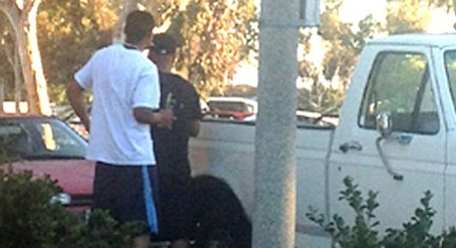 Men seen peering into every car as they strolled near Clairemont Village on June 19, between 7:30 and 7:45 p.m.