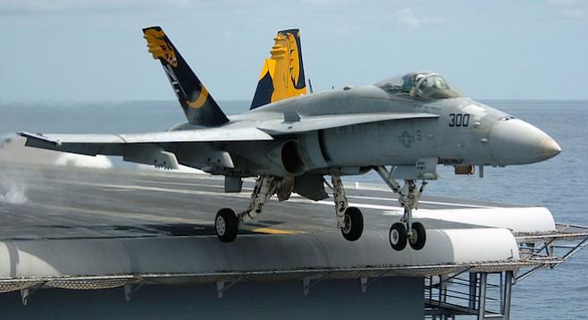 An F/A-18C Hornet launching from an aircraft carrier