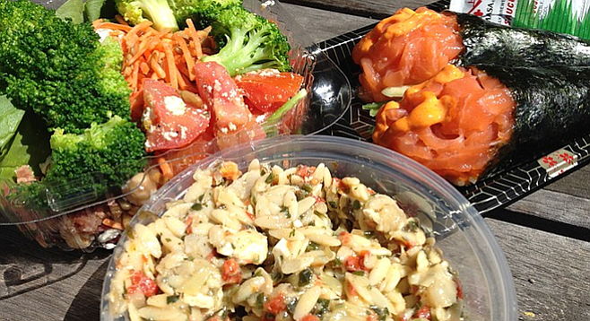Pesto orzo salad, spicy salmon hand rolls, and spinach salad