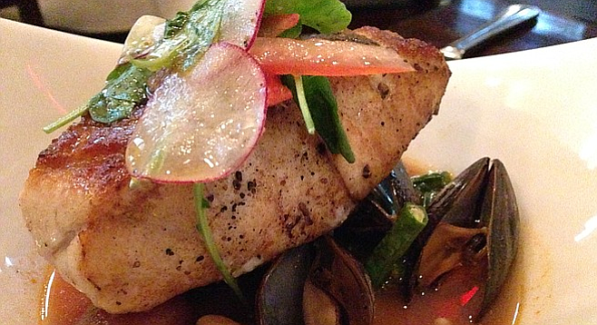 Crispy skin sea bass served with mussels in tamarind and tomato broth