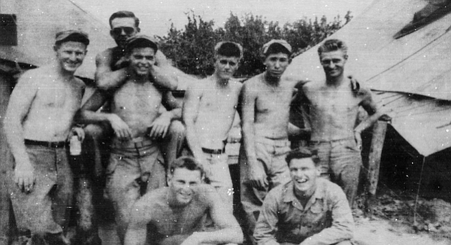 "Members of B Company, 1st Marine Division, 1st Motor Transport Battalion, Korea (Robert Weishan at far left). Weishan: ""There were terrible problems with high tides — at Inchon they ran 18 to 20 feet."""