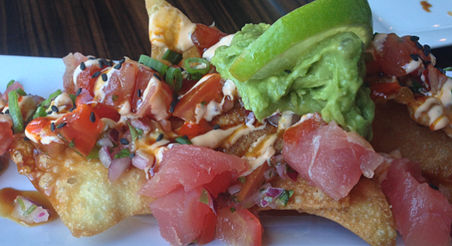 Buku Nachos put ahi tuna atop deep-fried wonton chips with guacamole and pico de gallo