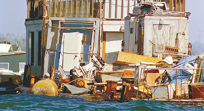 Many of the vessels are heaped with stuff, barrels, tarps, pieces of plastic, water buckets, nets, bits and pieces of other boats and usually, on top, a bicycle.