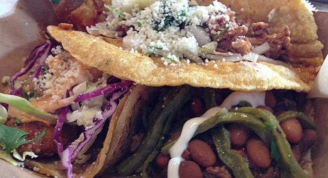 The Birria Taco (top) and the Taco de Barrio (right), plus a tasty fish taco (lower left)