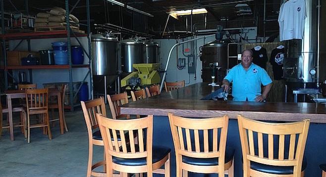 Bay Bridge co-founder Jim Shirey tends bar in his new tasting room.