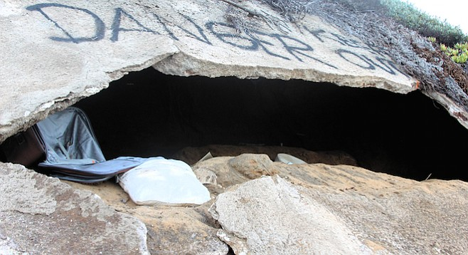 "Police spraypainted ""Danger Keep Out"" above this cave carved into the bluffs at the foot of Orchard Avenue."