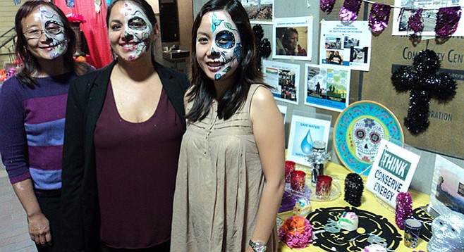 Quynh Njuyen, Isela Ramos and Trinh Le at climate change altar at the Day of the Dead kickoff party