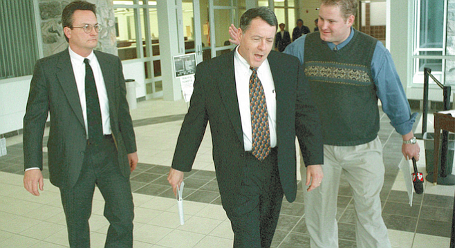 Robert Weitzel (left) and attorney Peter Stirba (center). Stirba has argued that much of the evidence against his client is circumstantial.