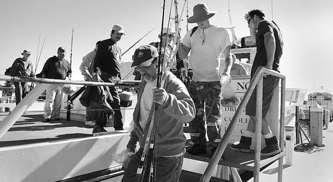 Fishermen disembarking the Dolphin