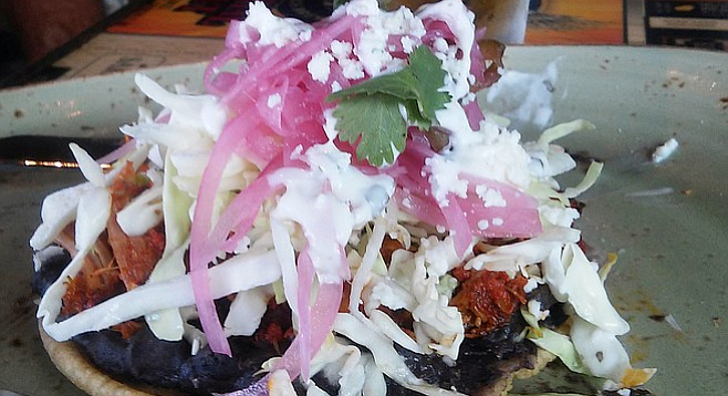 The Achiote Puffy Pork Taco, overwhelmed by red onion