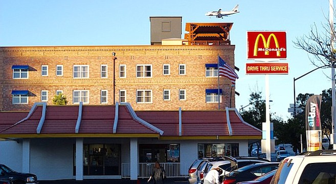Outside view of McD's with plane arriving