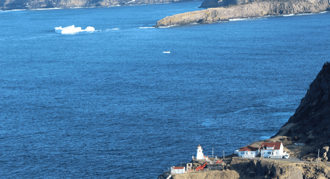 View from atop Newfoundland's Signal Hill, iceberg in the distance.