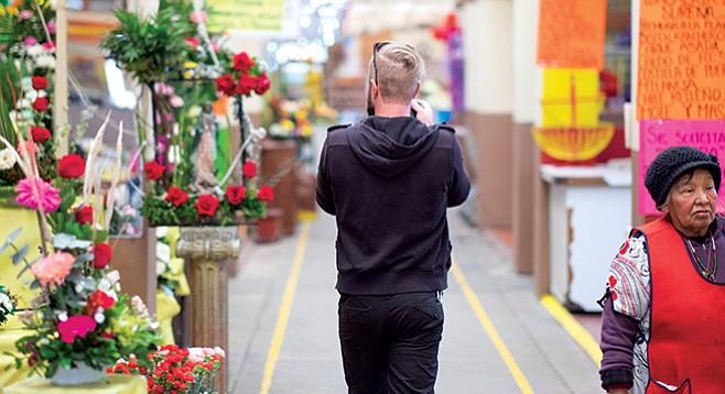 Chad Deal explores a market in La Zona