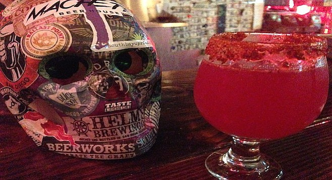 Tajin and chamoy salt the rim of Council's Prickly Pear Beatitude tart saison at Machete Beer House.