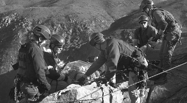 "BORSTAR team during cliff-rescue training in Laguna Mountains, 12/06/02. ""When we found the footprints and started following them, we kept noticing very small footprints."""