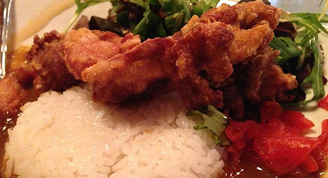 Karaage Chicken atop curry and rice