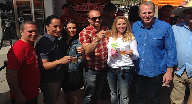 Mayor Kevin Faulconer and Councilman Todd Gloria celebrate the arrival of craft beer tasting at Hillcrest Farmers Market.