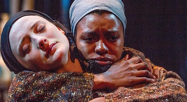Polina Andreevna (Makha Mthembu) consoles perpetually drunken, heartbroken Masha (Talley Beth Gale).