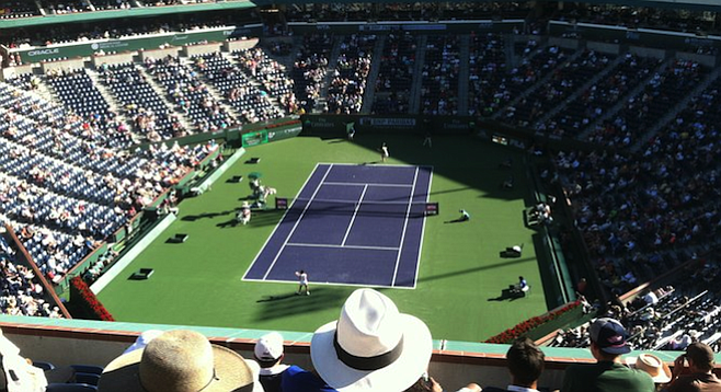 Taking in the action and desert sun from the Indian Wells grandstand.