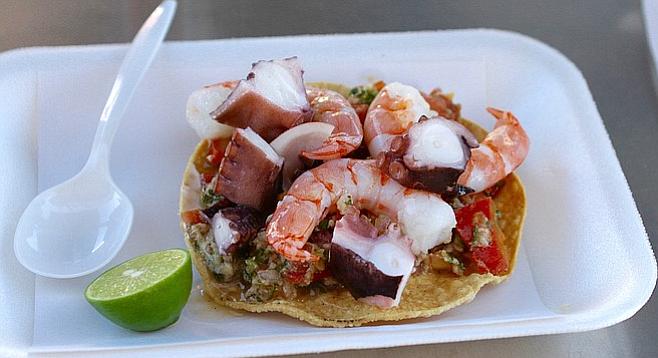 Fish, shrimp, and octopus ceviche tostada