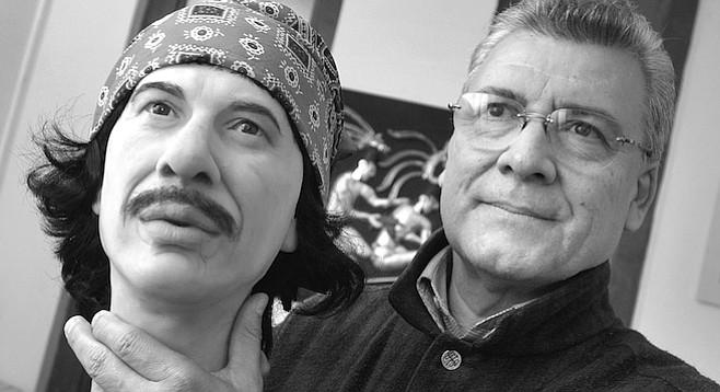 Ricardo Parra Montes holding Carlos Santana wax head