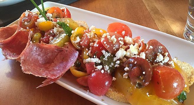 Tomato salad with feta, capers, watermelon, and soppressata