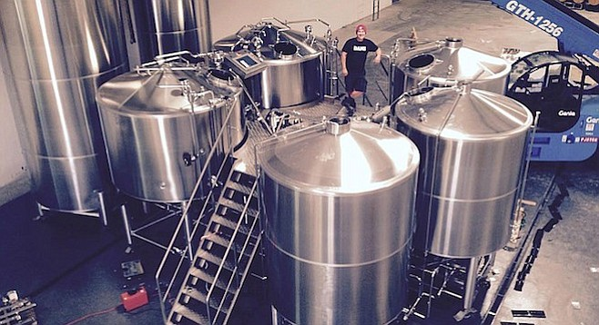 Belching Beaver brewmaster Troy Smith stands in the company's large new production facility in Oceanside.