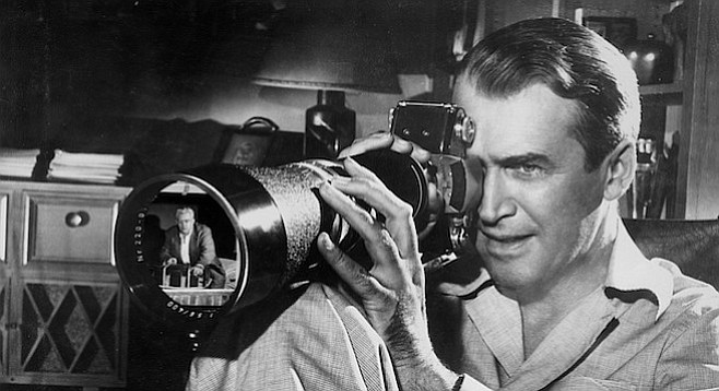 James Stewart sets his sights on Ray Burr in Alfred Hitchcock's Rear Window.