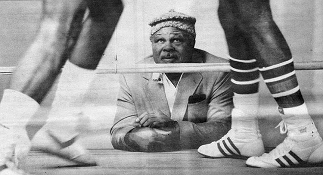 Archie Moore, 1985. The swimming pool in the shape of a boxing glove is empty now, and I-15 traffic rumbles constantly alongside Moore's weedy lot.